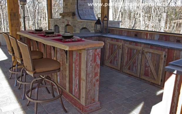 outdoor bar where there is a perfect arrangement of a large wooden ...
